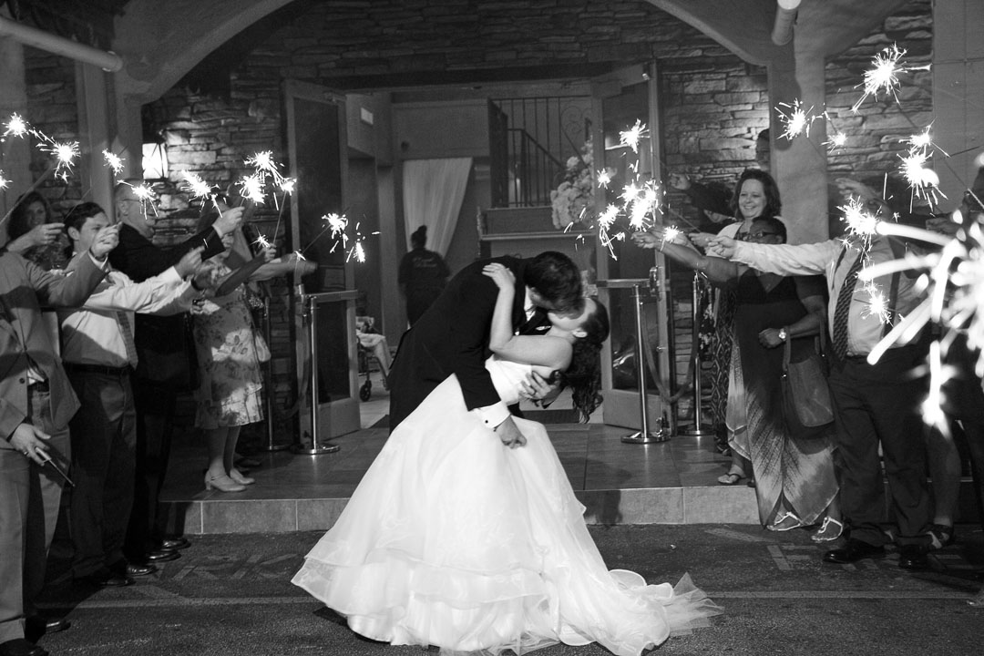 Daytona Beach wedding photography, Sarah Rose Photography. Groom dipping bride during sparkler send off and grand exit at Crystal Ballroom on the Lake in Altamonte Springs, Florida.